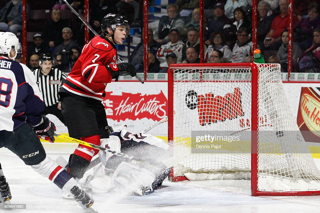 Forward Zachary Roberts #7 of the Owen Sound Attack scores a third period go ahead goal against goaltender Michael DiPietro #64 of the Windsor Spitfires on November 17, 2016 at the WFCU Centre in Windsor, Ontario, Canada.