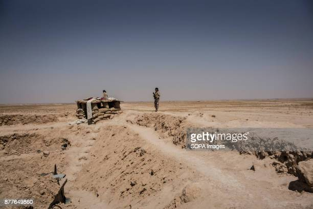 A forwarding outpost of Quwat Al Nukhba over looks a village held by ISIS only a few km away in Al Shaddadi district The desert of Al Shaddadi is...