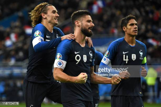Forwards Antoine Griezmann of France congratulates Olivier Giroud forward of France after his goal during the UEFA Euro 2020 Qualifier match between...