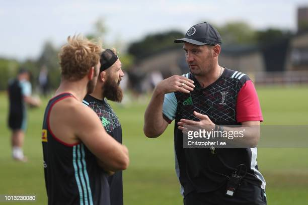 Forwards Coach Alex Codling talks to Chris Robshaw and Joe Marler during the Harlequins PreSeason Training Session at Surrey Sports Park on August 8...