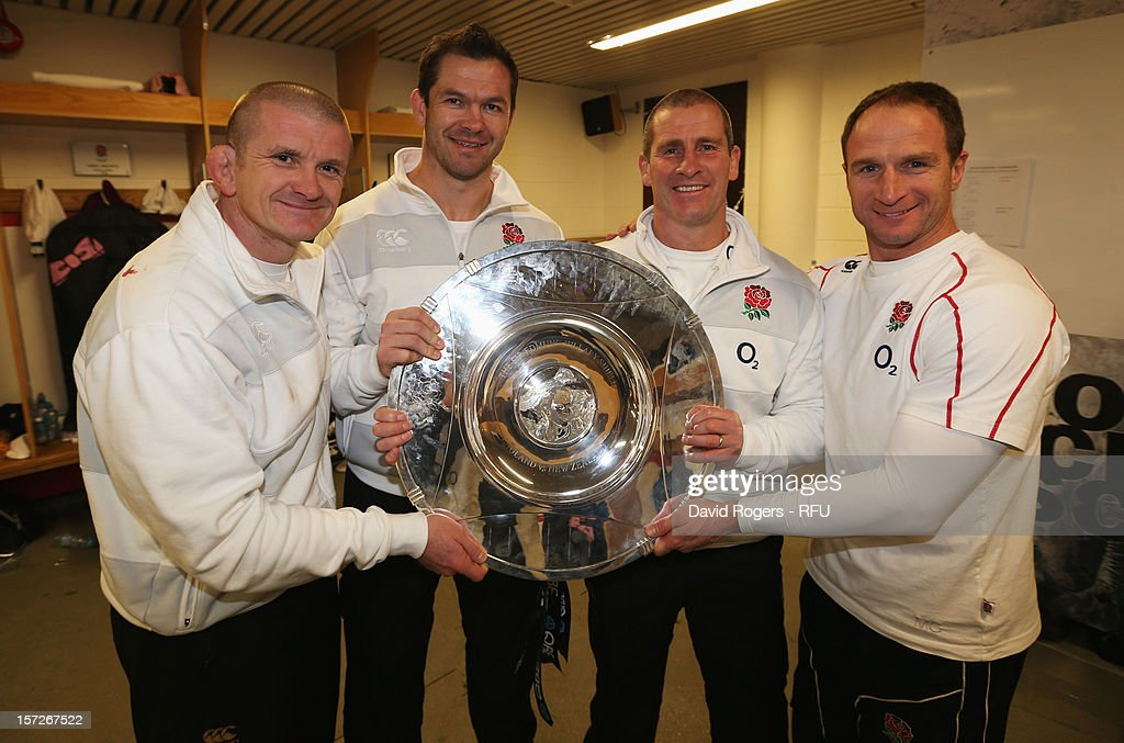 Forwards coach Graham Rowntree, backs coach Andy Farrell of England, Head Coach Stuart Lancaster of England and attacking skills coach Mike Catt of England pose with Sir Edmund Hillary shield in the changing room after the QBE International match between England and New Zealand at Twickenham Stadium on December 1, 2012 in London, England.
