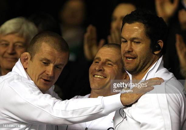 Forwards coach Graham Rowntree, Stuart Lancaster, head coach of England and England Backs Coach Andy Farrell celebrate at the final whistle during...