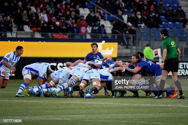 Forwards compete in a scrum during the French Top 14 rugby union match between Grenoble and Castres Olympique on january 5 2019 at the Stade des...