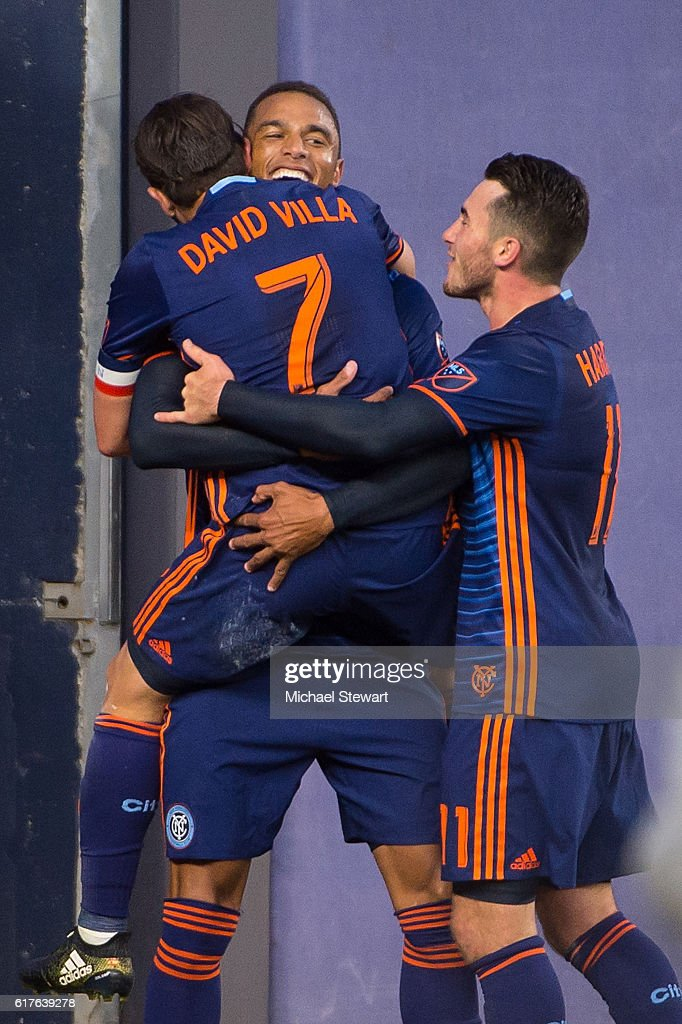 Forwards David Villa #7 and Khiry Shelton #19 of New York City FC celebrate after scoring a goal during the match vs Columbus Crew SC at Yankee Stadium on October 23, 2016 in New York City. New York City FC defeats Columbus Crew SC
