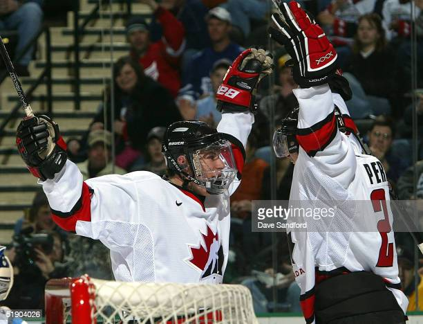 Forwards Sidney Crosby and Corey Perry both of Team Canada celebrate Perry's goal against Team Finland during the World Junior Hockey Championship...