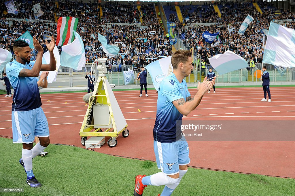 Foryna Wallace and Lucas Biglia of SS Lazio before the Serie A match between SS Lazio and AS Roma at Stadio Olimpico on December 4, 2016 in Rome, Italy.