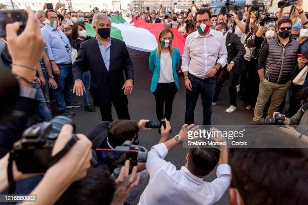 Forza Italia European deputy Antonio Tajani Fratelli d'Italia leader Giorgia Meloni and Lega leader Matteo Salvini attend a demonstration against the...