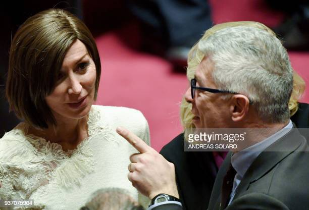 Forza Italia senator Anna Maria Bernini talks with a senator at the Senate during the first session in Rome on March 23 2018 following the March 4...