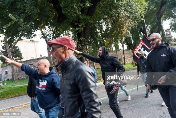 Forza Nuova militants do the Nazi salute during a demonstration organised by the farright group near Romes San Lorenzo neighbourhood on October 27 a...