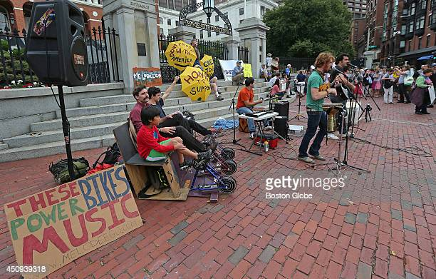 Fossil fuel divestment activists rally on the steps in front of the State House Growing movement among environmentalists to get pension funds...