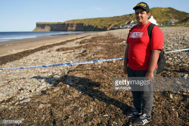 Fossil hunter Azaan Jamil from Leeds poses for a pictures after he discovered a hand grenade while hunting for fossils on Saltburn beach on September...