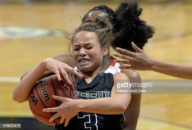 Fossil Ridge's Savannah Smith battles for control of the ball against Regis' Neffie Lockley in the first half The Regis Jesuit Raiders take on the...
