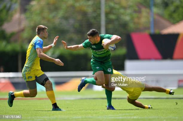Foster Horan of Ireland is tackled by Vladyslav Adazhynyk and Vadym Sivak of Ukraine during the Group B match between Ireland and Ukraine on day one...