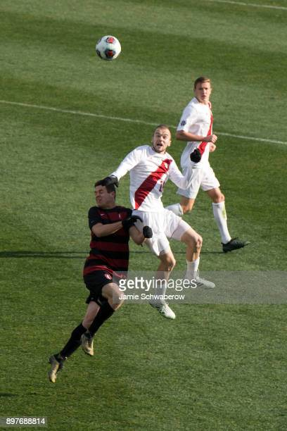 Foster Langsdorf of Stanford University and Andrew Gutman of Indiana University battle for the ball during the Division I Men's Soccer Championship...