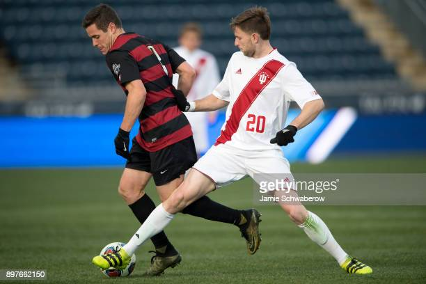 Foster Langsdorf of Stanford University and Timmy Mehl of Indiana University battle for the ball during the Division I Men's Soccer Championship held...