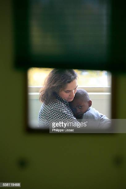 Foster Mother Holding Sick Child