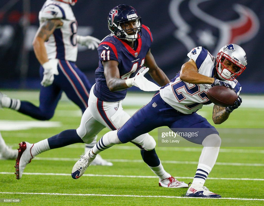 D.J. Foster #27 of the New England Patriots makes a catch in front of Zach Cunningham #41 of the Houston Texans at NRG Stadium on August 19, 2017 in Houston, Texas.