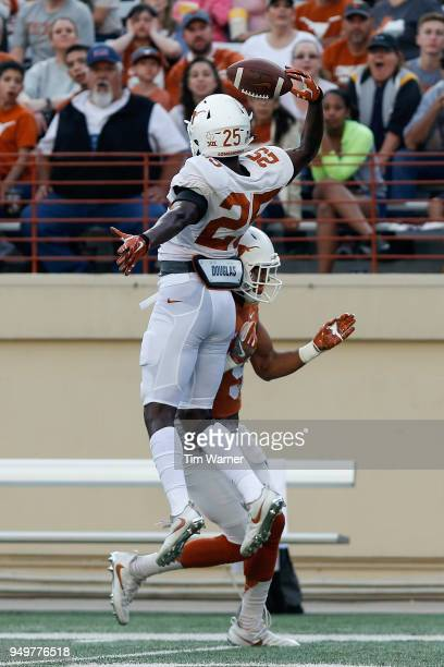 J Foster of the Texas Longhorns breaks up a pass intended for Collin Johnson in the first half during the OrangeWhite Spring Game at Darrell K...