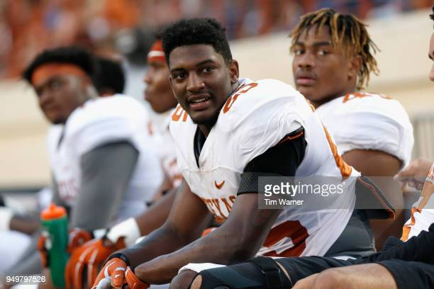 J Foster of the Texas Longhorns rests on the bench in the first half during the OrangeWhite Spring Game at Darrell K RoyalTexas Memorial Stadium on...