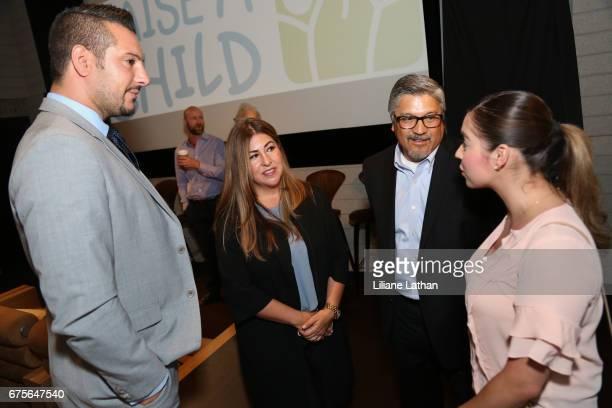 Foster Parents Dana Valenzuela Jesse Marez and guests attend the Reveal of the RaiseAChild's 'Reimagine Foster Parents' Campaign at NeueHouse...