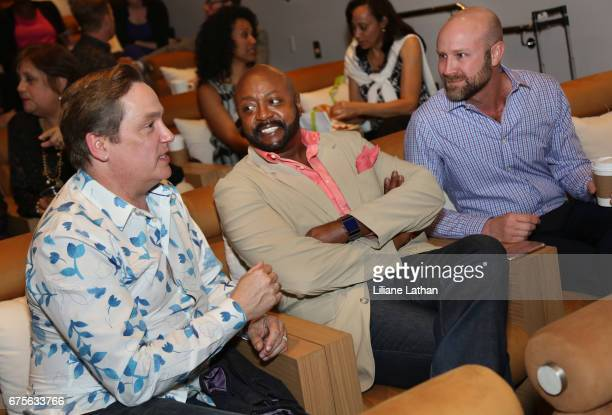 Foster parents Ross Smith Aaron Knight and Director of Development and Communications at the Village Family Services Zachery Scott attend the reveal...