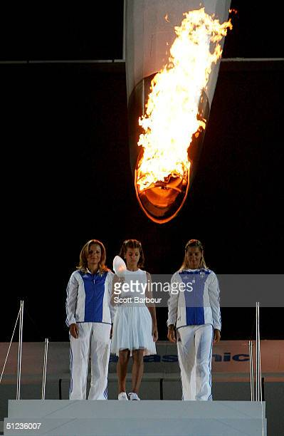 Fotini Papaleonidopoulou, 10 years-old, carries a lantern with the light taken from the cauldron flame during the closing ceremonies of the Athens...
