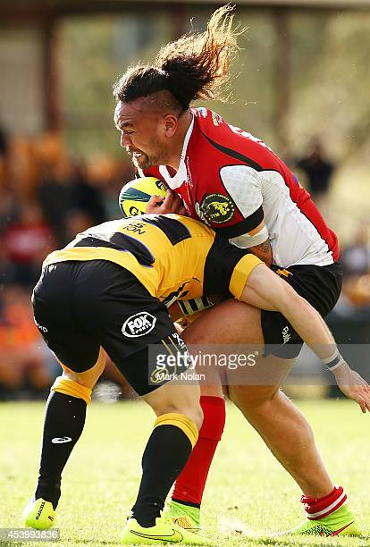 Fotu Auelua of the Vikings is tackled during the round one National Rugby Championship match between the Canberra Vikings and Perth Spirit at Viking...