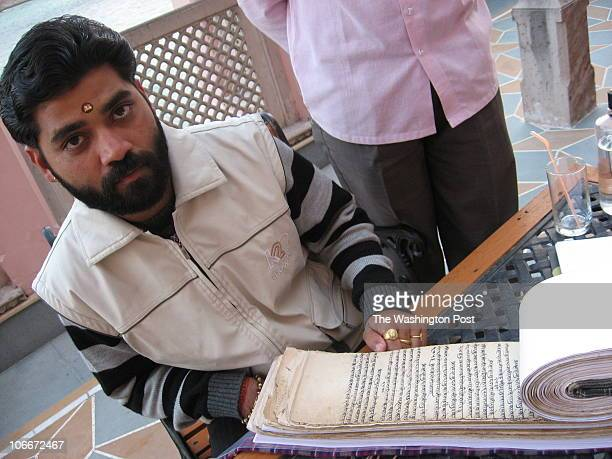 IndiaGanga DATE: Downloaded email CREDIT: Emily Wax/TWP Haridwar, India Ashish Sharma Pawan who is leaning over this 144-year old record book that...