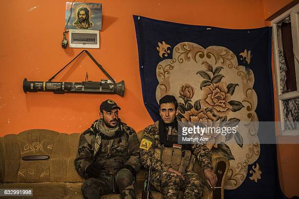 Fouad 27 years old and Ahmed 25 years old are Shabak fighters of the Hashid AlShaabi's Babylon Brigade They rest after a patrol at their base in...