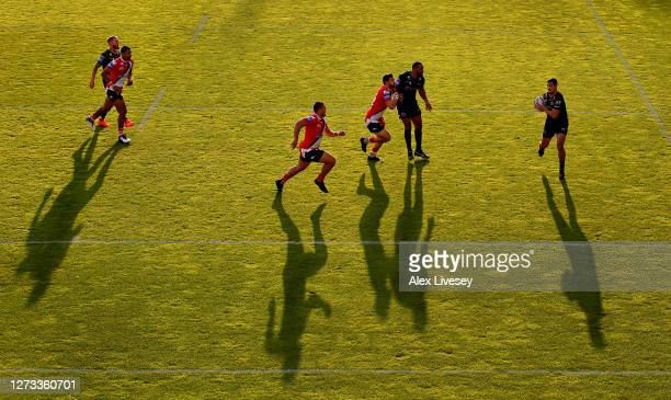 Fouad Yaha of Catalans Dragons collects the ball on the way to scoring the opening try during the Coral Challenge Cup Quarter Final match between...