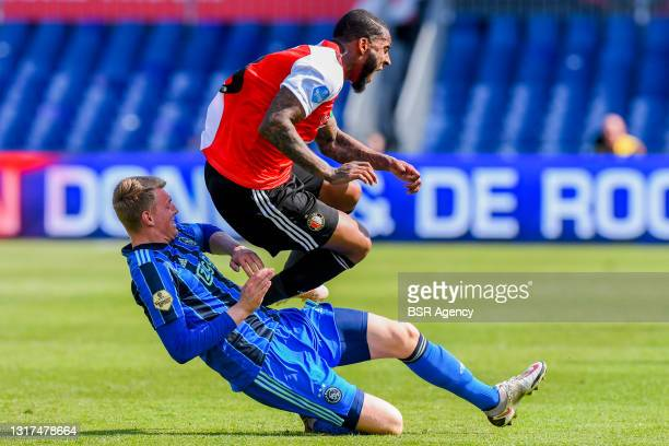 Foul by Perr Schuurs of AFC Ajax to Leroy Fer of Feyenoord Rotterdam during the Dutch Eredivisie match between Feyenoord Rotterdam and Ajax at...