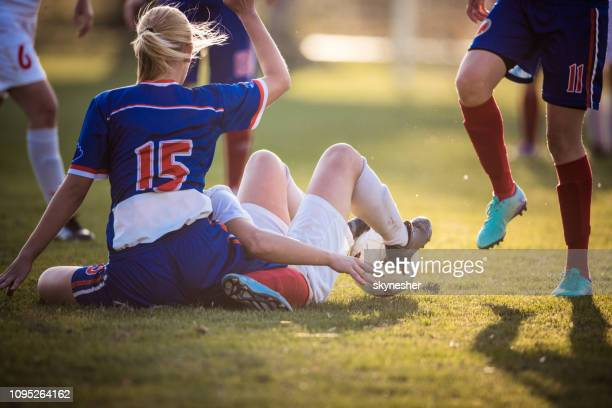 foul on women's soccer match! - foul sports stock pictures, royalty-free photos & images
