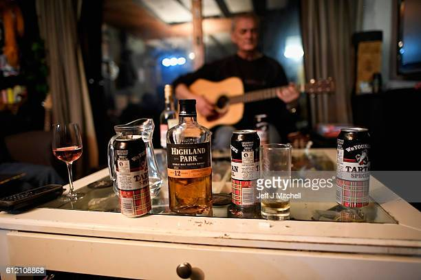 Foula resident Davie Wilson plays to Stuart Taylor Penny Grear Sheila GrearJim Grear at a late night gathering on October 2 2016 in Foula Scotland...