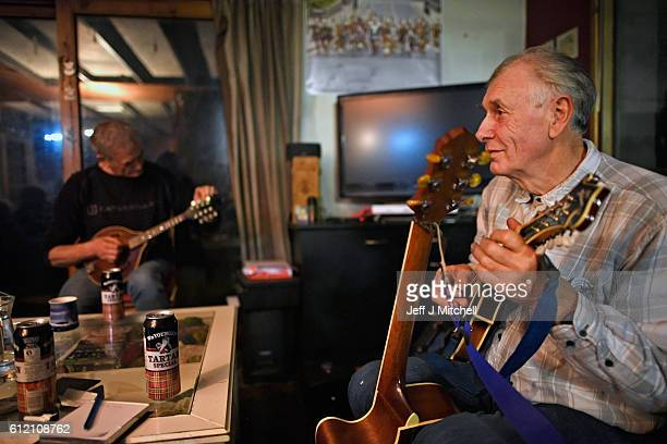 Foula resident Jim Grear plays to Stuart Taylor Penny Grear Sheila Grear and Davie Wilson at a late night gathering on October 2 2016 in Foula...