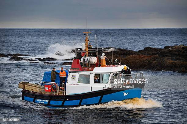 Foula residents arrive back at the island on the New Advance with supplies from Shetland on October 1 2016 in Foula Scotland Foula is the remotest...