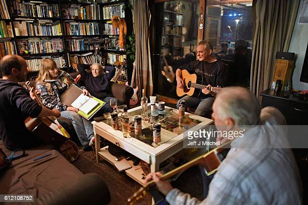 Foula residents Stuart Taylor Penny Grear Sheila Grear Davie Wilson and Jim Grear play music and enjoy a drink at a late night gathering on October 2...