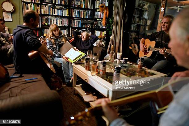 Foula residents Stuart Taylor, Penny Grear, Sheila Grear, Davie Wilson and Jim Grear play music and enjoy a drink at a late night gathering on...