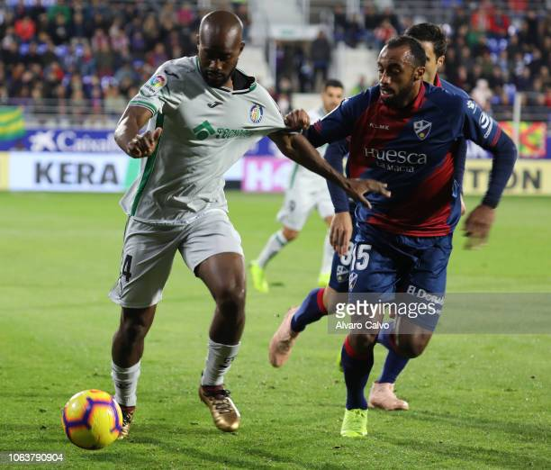 Foulquier of Getafe and Akapo of Huesca during the La Liga match between SD Huesca and Getafe at El Alcoraz on November 5 2018 in Huesca Spain