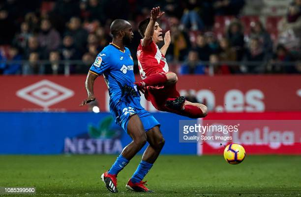 Foulquier of Getafe FC commits fault to Pere Pons of Girona FC during the La Liga match between Girona FC and Getafe CF at Montilivi Stadium on...