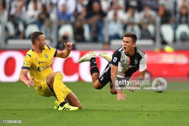Fouls on Paulo Dybala of Juventus during the Serie A match between Juventus and Hellas Verona at Allianz Stadium on September 21, 2019 in Turin,...