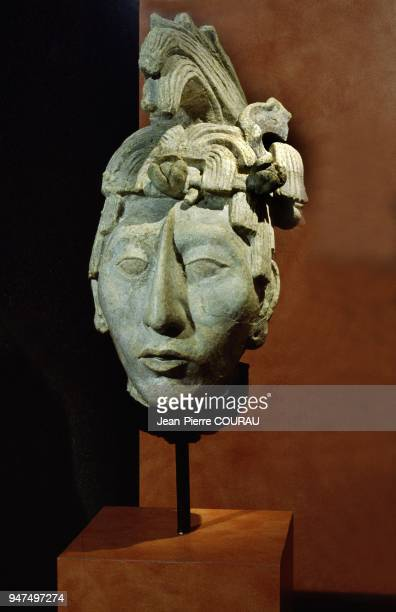 Found in the crypt of the temple of inscriptions near Pacal's tomb this juvenile face with tangled hair could represent him as a young person or...