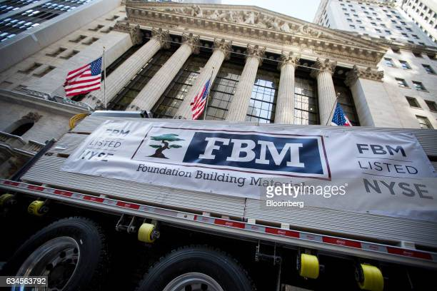 Foundation Building Materials LLC signage is displayed on a truck in front of the New York Stock Exchange during the company's initial public...