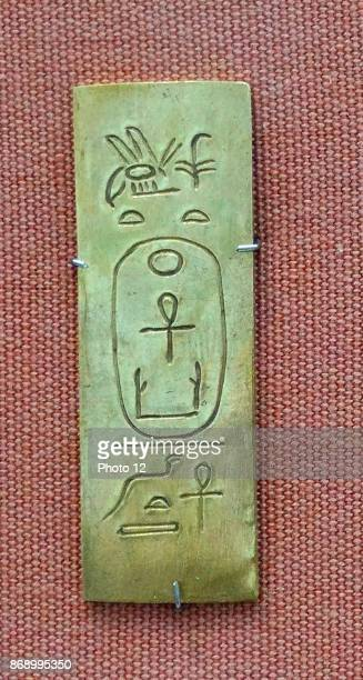 Foundation deposit of King Malenaqen Napatan Period about 555542 BC From Nuri pyramid Nu 5 Egypt Faience cartoucheplaque made of gold