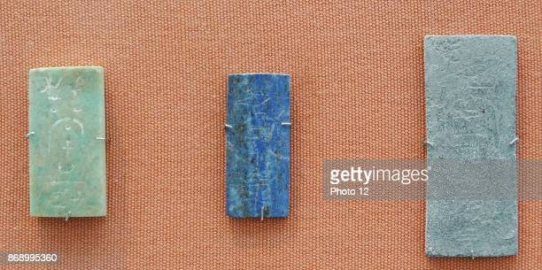 Foundation deposit of King Malenaqen Napatan Period about 555542 BC From Nuri pyramid Nu 5 Egypt Faience cartoucheplaque and tablets made of...