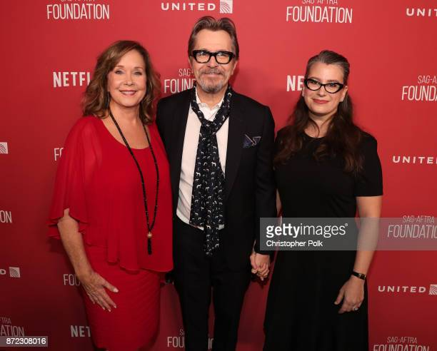 SAGAFTRA Foundation Executive Director Cyd Wilson Gary Oldman and Gisele Schmidt attend the SAGAFTRA Foundation Patron of the Artists Awards 2017 at...