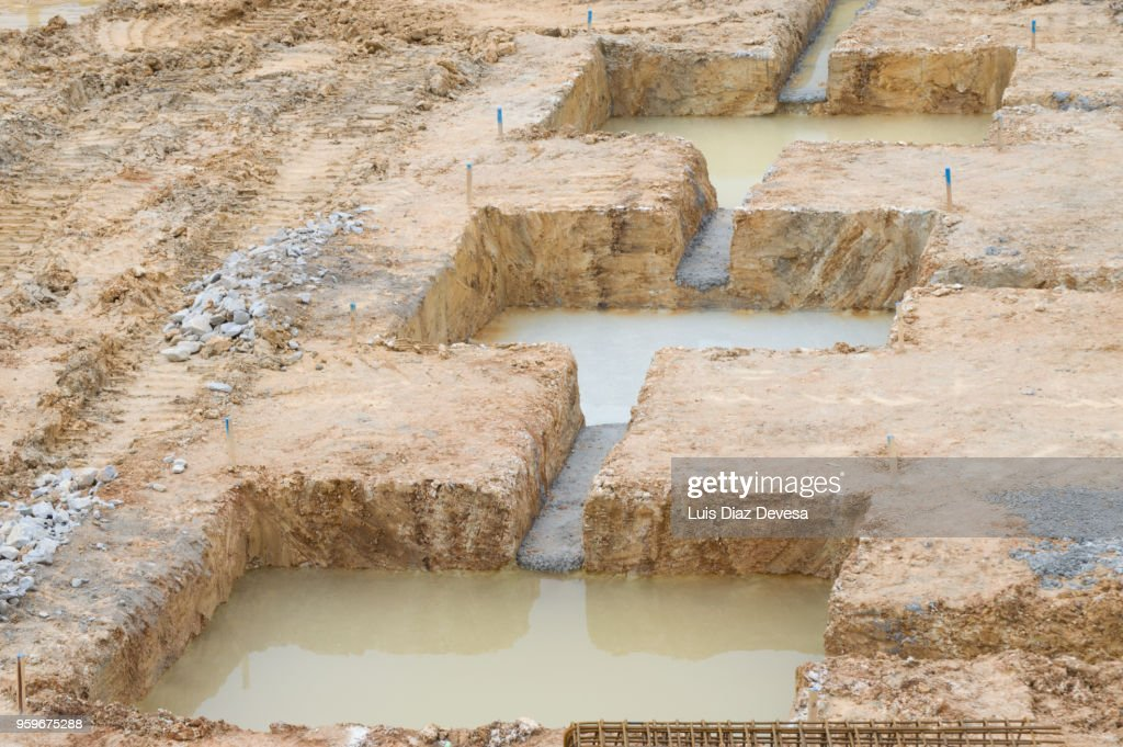 Foundation holes at different stages : Stock-Foto