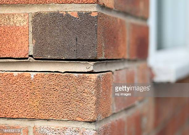 Foundation problems causing house bricks to part.