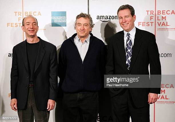 Founder and CEO of Amazoncom Jeff Bezos Tribeca Film Festival founder Robert De Niro and chief marketing officer of American Express John Hayes pose...