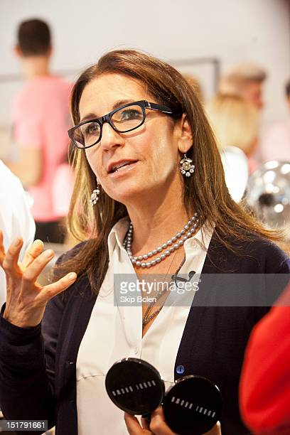Founder and CEO of Bobbi Brown Cosmetics, Bobbi Brown prepares the makeup on a model backstage at the Rachel Roy presentation during Spring 2013...