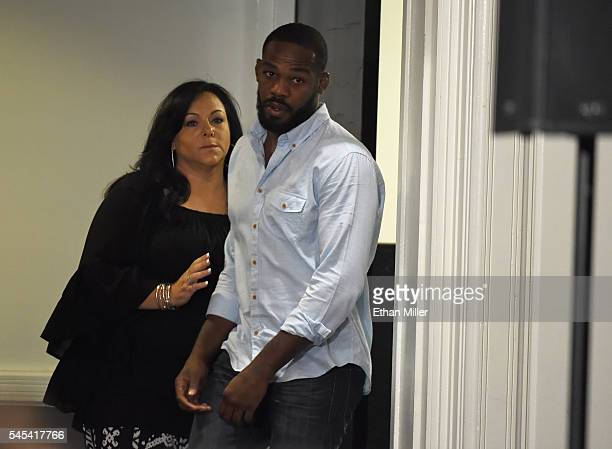 Founder and CEO of EAG Sports Management Denise White walks with mixed martial artist Jon Jones as he returns after temporarily leaving a news...